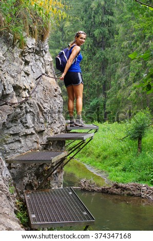 Young woman on the trail along the Hornad river, Slovak Paradise