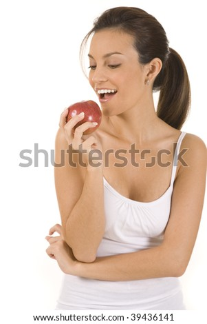 Young woman on white holding an apple. - stock photo