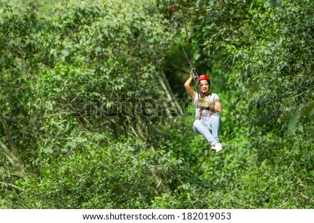 YOUNG WOMAN ON ZIP LINE