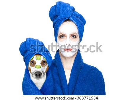 young woman or girl  with beauty facial cream mask on face  with jack russell dog with wellness treatment, isolated on white background - stock photo