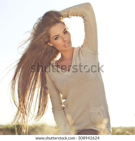 Young woman outdoor  in soft sunny daylight - stock photo