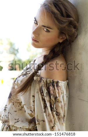 Young woman outdoor portrait. Soft sunny colors - stock photo