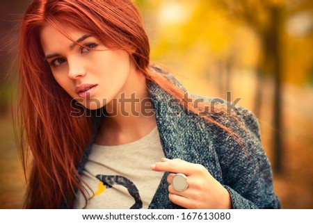 Young woman outdoors autumn portrait. - stock photo