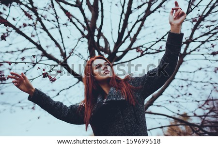 Young woman outdoors autumn portrait. Film style colors. - stock photo