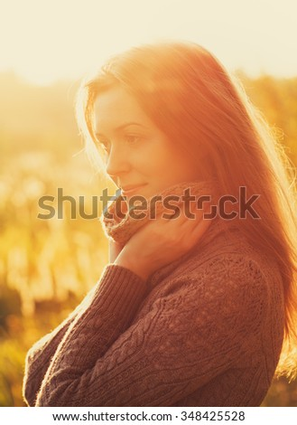 Young woman outdoors autumn sunny portrait - stock photo