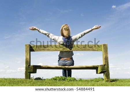 Young Woman Outdoors Celebrating Or Worshiping God - stock photo