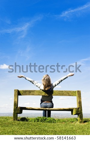 Young Woman Outdoors, Celebrating Or Worshipping God