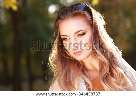 Young woman outdoors fashion portrait. Soft sunset light