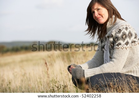 Young Woman Outdoors In Autumn Landscape - stock photo