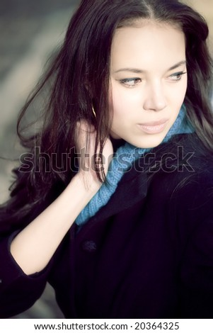 Young woman outdoors portrait. Soft blue tint. - stock photo