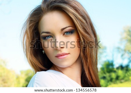 Young woman outdoors portrait. Soft sunny colors. - stock photo