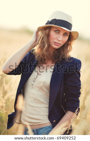 Young woman outdoors portrait. Soft yellow tint. - stock photo