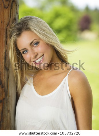 Young woman outside with a healthy smile