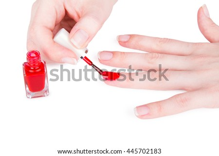 Young woman paint her nails. On white.