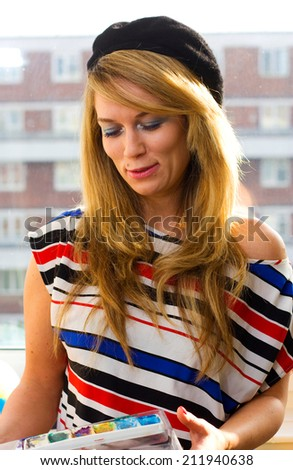 young woman painting. - stock photo