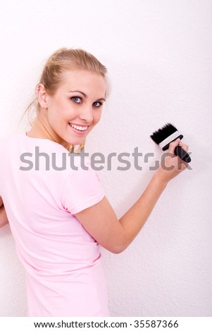 young woman painting new home - stock photo