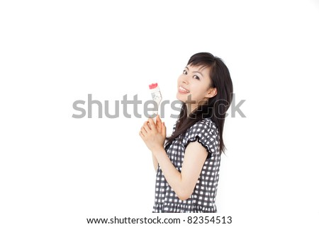 young woman painting something with paintbrush, isolated on white background
