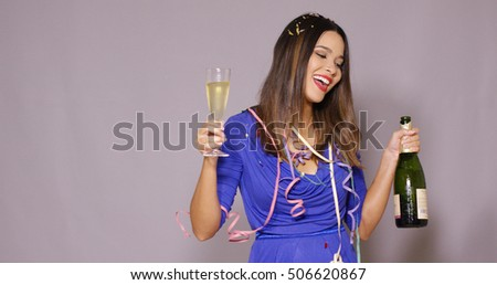 Young woman partying as she celebrates New Year