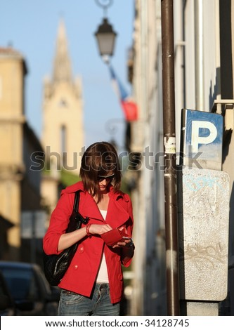 Young woman paying the parking fee - stock photo