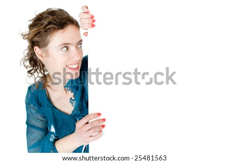 young woman peeping from blank billboard  over white