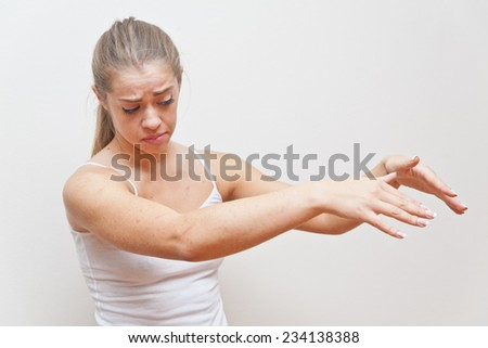 young woman performing hand gesture that stands for AWAY FROM ME or go away from me - stock photo