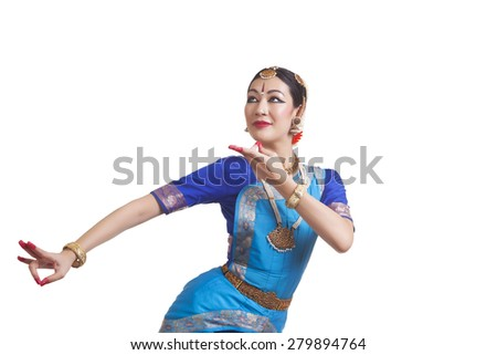 Young woman performing Indian Bharat Natyam dance over white background - stock photo