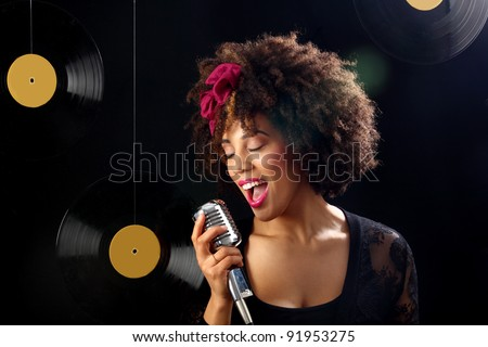 young woman performing on stage geniune lens flare included - stock photo