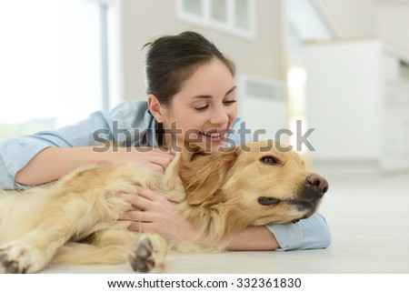 Young woman petting her dog