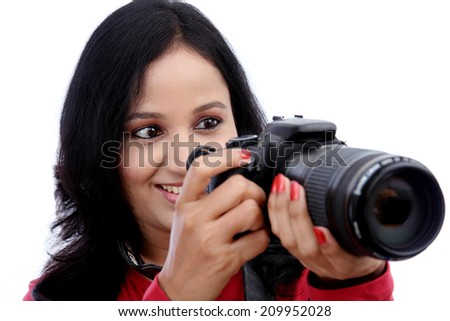 Young woman photographer shooting images - stock photo