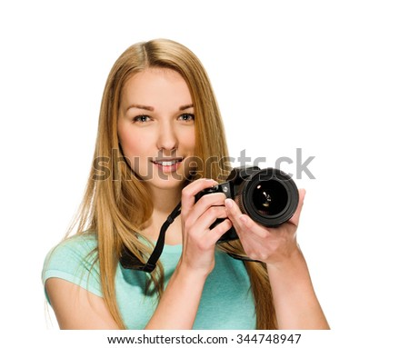 young woman photographer with camera on tripod