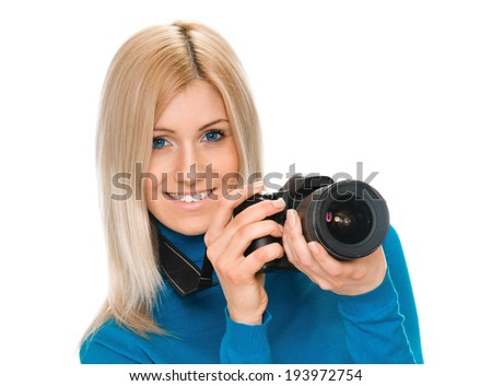 young woman photographer with camera. on white