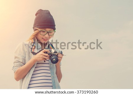 Young woman photography looking photo from camera