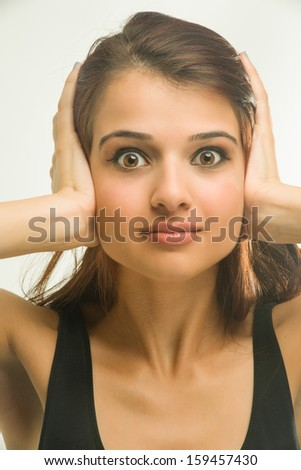 Young woman playing deaf and ignoring - stock photo