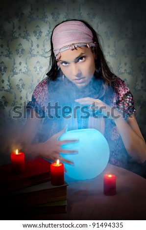 Young woman playing fortune-teller - stock photo