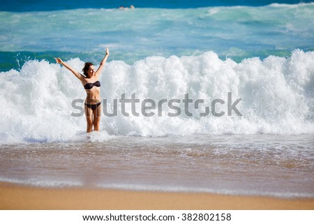 Young woman playing in big waves, Barcelona, Spain - stock photo