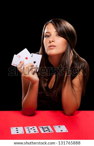young woman playing in the gambling in casino