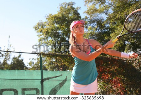 young woman playing tennis - stock photo