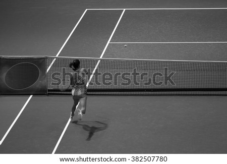 Young woman playing tennis. Girl playing tennis on the court .  black and white photo. - stock photo