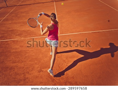 Young woman playing tennis.High angle view.Forehand. - stock photo