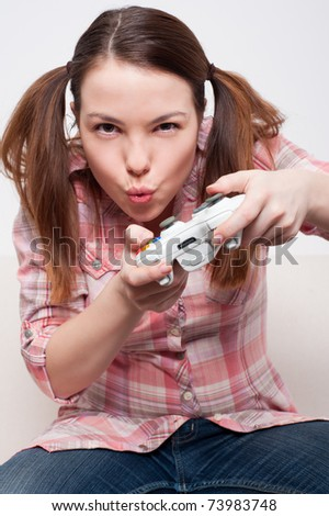 young woman playing video game - stock photo