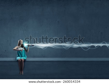 Young woman playing violin against blank background - stock photo