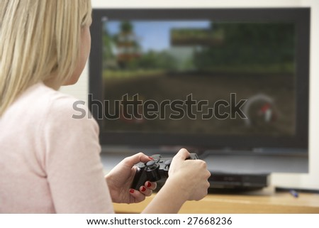 Young Woman Playing With Game Console
