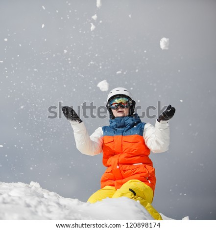 Young Woman Playing with snow - stock photo