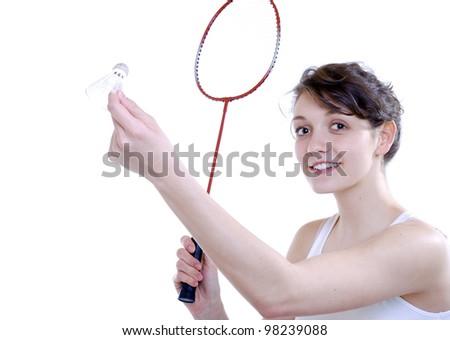 young woman plays badminton - stock photo