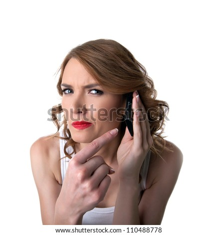 Young woman point on cell phone with suspicious - stock photo