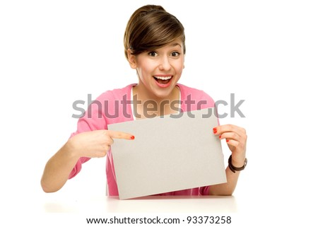Young woman pointing at blank poster