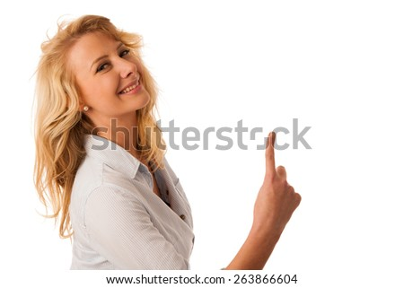 young woman pointing into copy space - stock photo