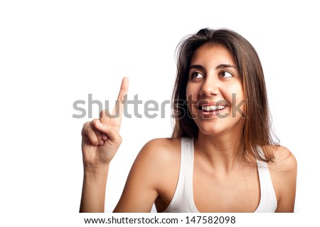 young woman pointing something isolated on a white background - stock photo