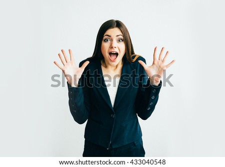 Young woman pointing with a hand and showing surprise isolated on white background - stock photo