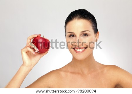 Young woman portrait and red apple in her hand